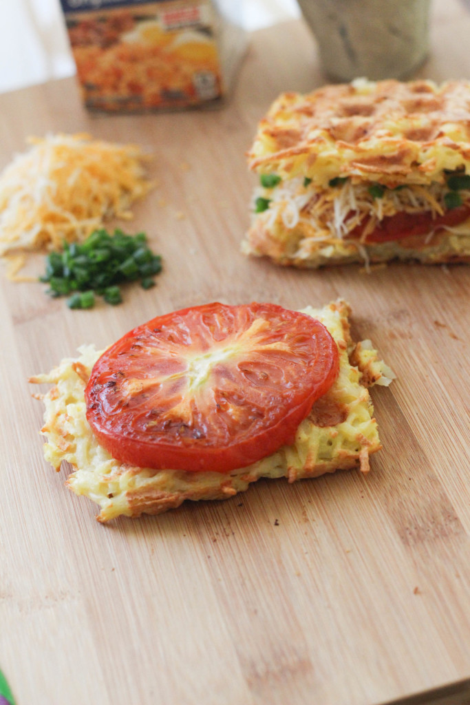 Waffle iron Hashbrown Sandwich with grilled tomato shredded cheese and chives Hungry Jack The Frosted Petticoat 8 683x1024 - Waffle-Iron Hashbrown Sandwiches